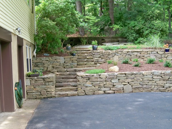 image of a tiered retaining wall design grandview landscape - Landscape Design Retaining Wall Ideas